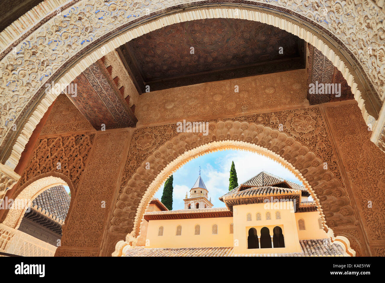 GRANADA, SPAIN - JUNE 29, 2017: Alhambra, the complete Arabic form of which was Qalat Al-Hamra, is a palace and - Stock Image
