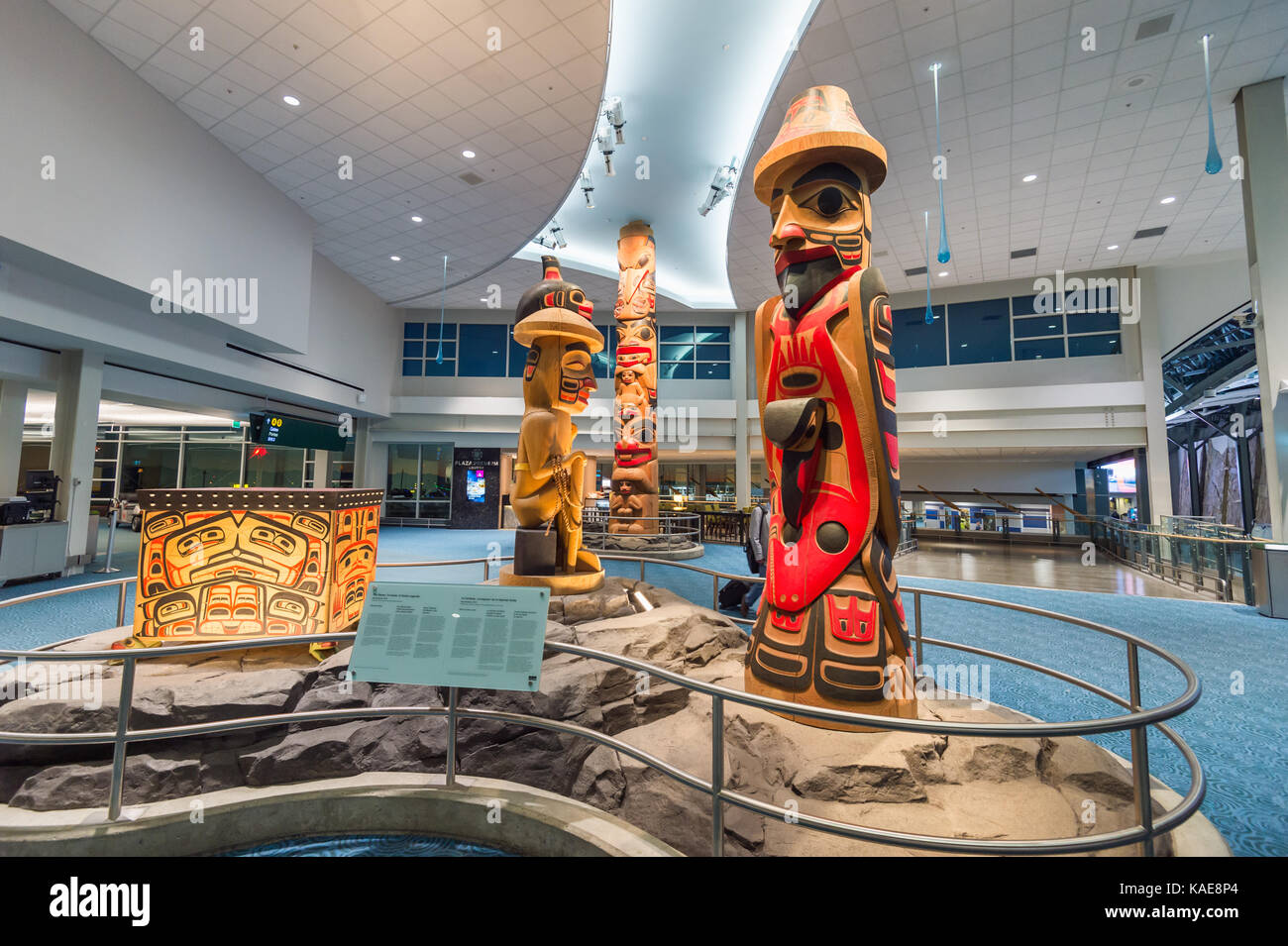 Reg Davidson sculpture 'the Raven, trickster of Haida legends' in the domestic terminal at Vancouver International - Stock Image
