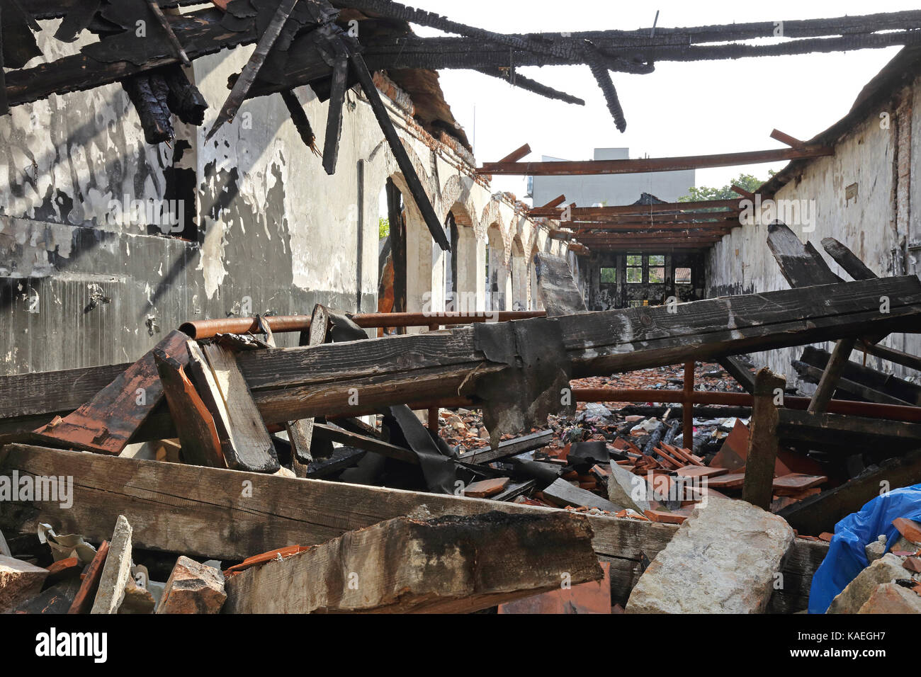 Burned Wooden Structure in Factory After Fire Disaster - Stock Image
