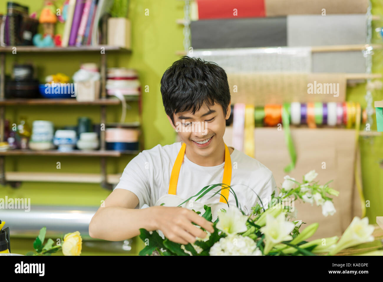 Portrait of smiling flower shop owner working. Small business. Stock Photo