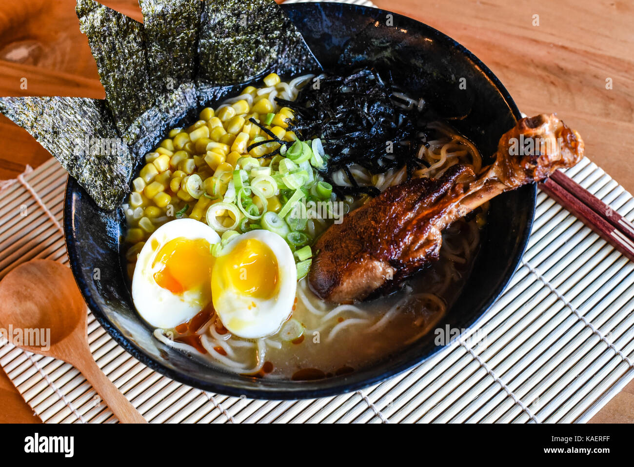 Chicken Miso Ramen, Flavor packed with a blended miso paste. Topped with buttered corn and chicken drumstick. - Stock Image