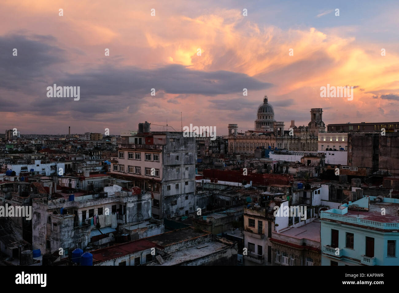The view over the rooftops of Centro Habana and Habana Vieja at sunset during a hot summer in Havana, Cuba. - Stock Image