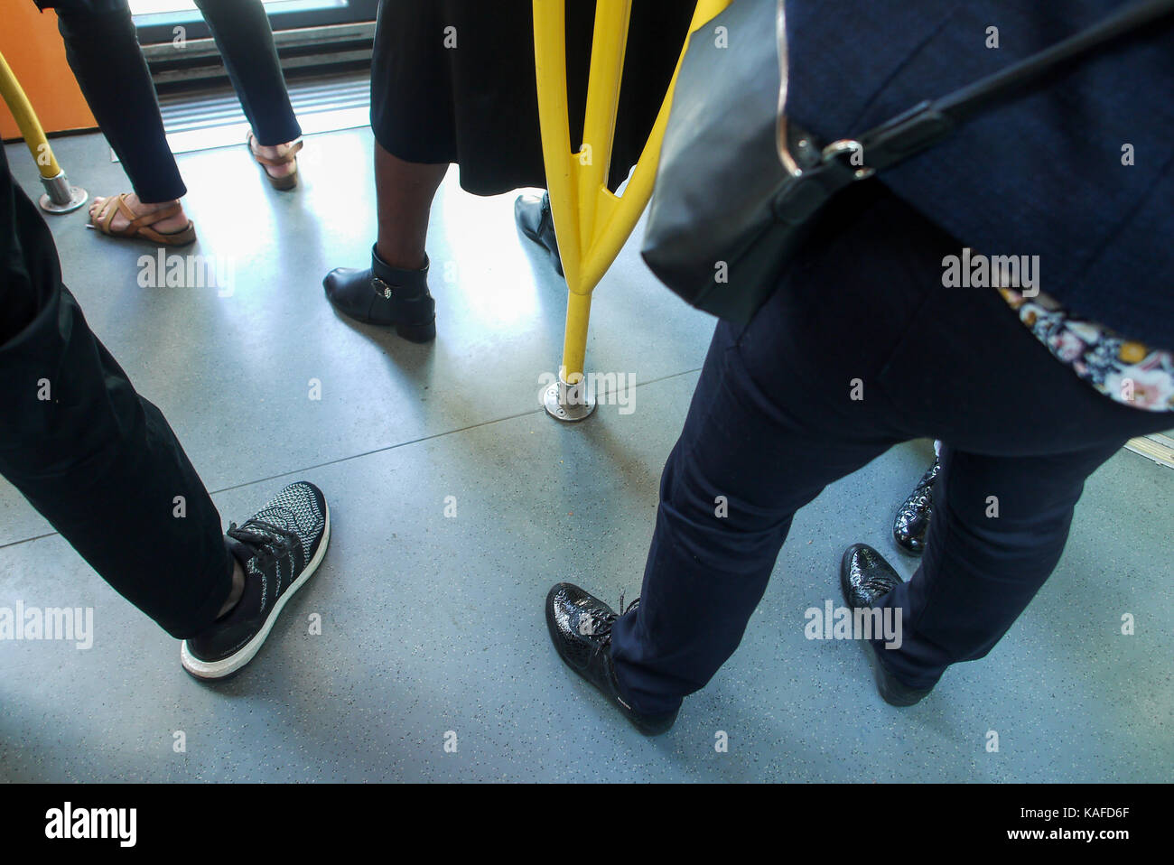 People stand in T3 tramway, Paris, france - Stock Image