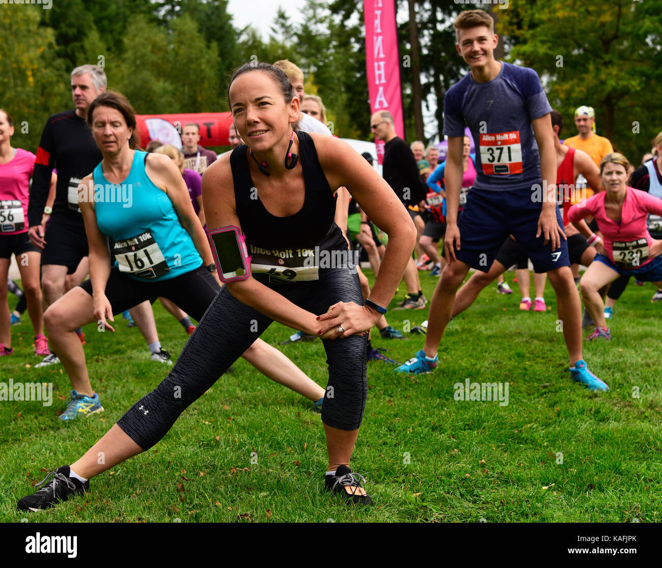 Group of runners warming up prior to a 5km & 10km race, Alice Holt Forest, Farnham, Surrey, UK. Saturday 23 - Stock Image