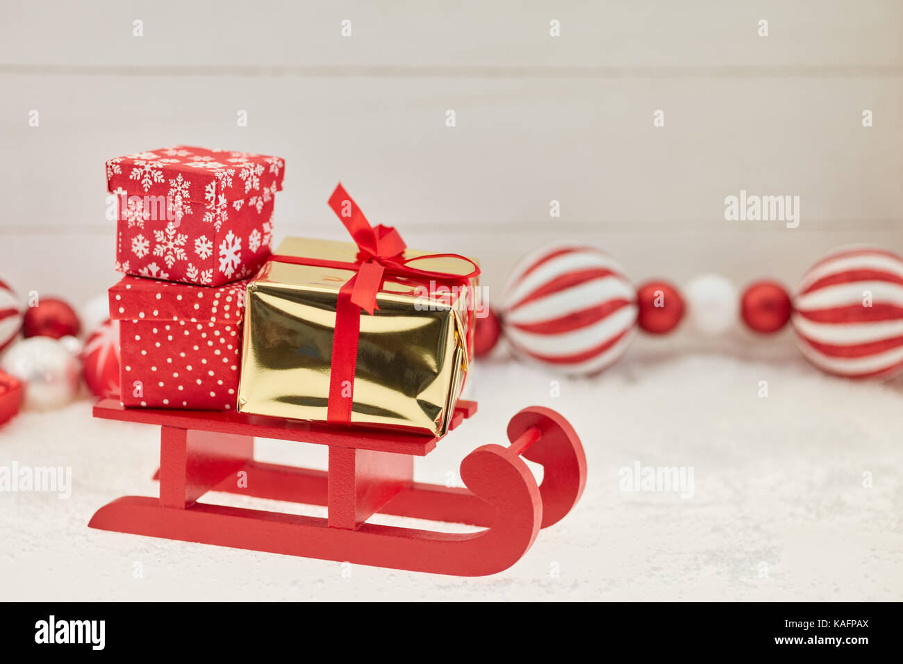 Christmas delivery shipping sled background with many gifts and ...