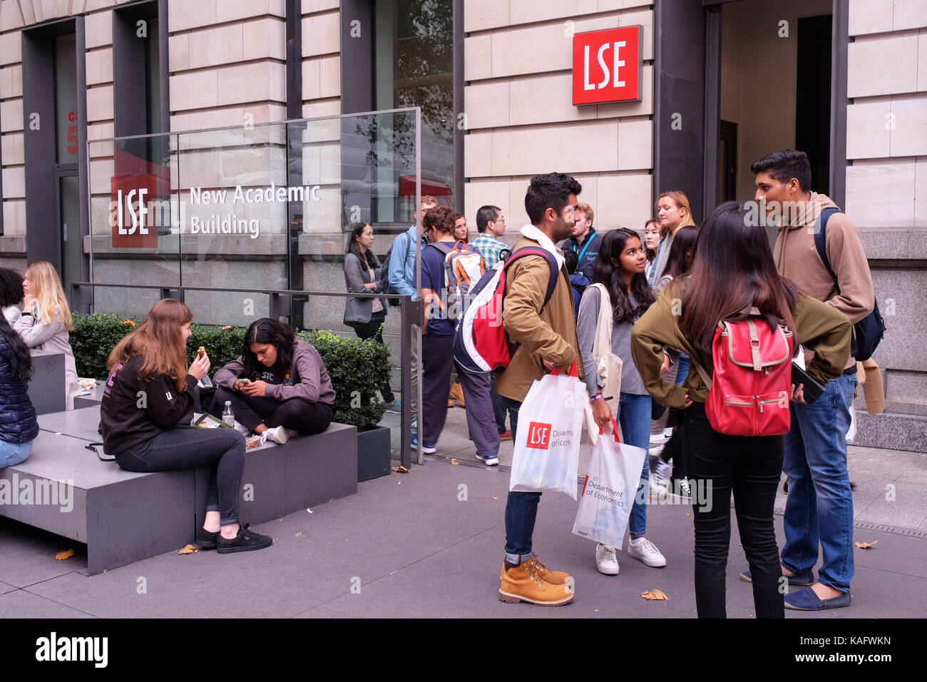 Students attending the London School of Economics and Political Science outside the university's New Academic - Stock Image