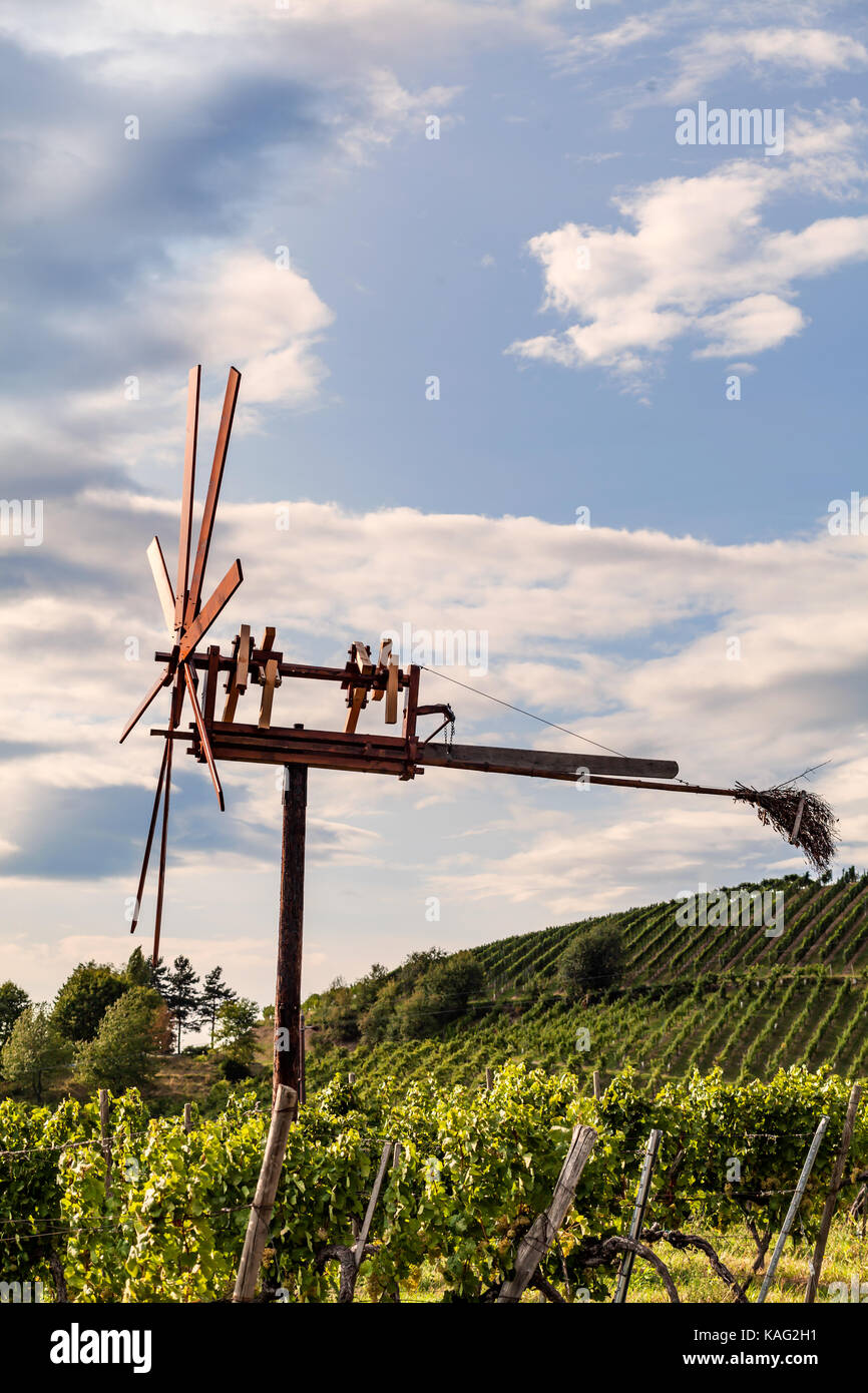 Windmill called Klapotetz in vineyard along the south Styrian vine route in Austria, Europe - Stock Image