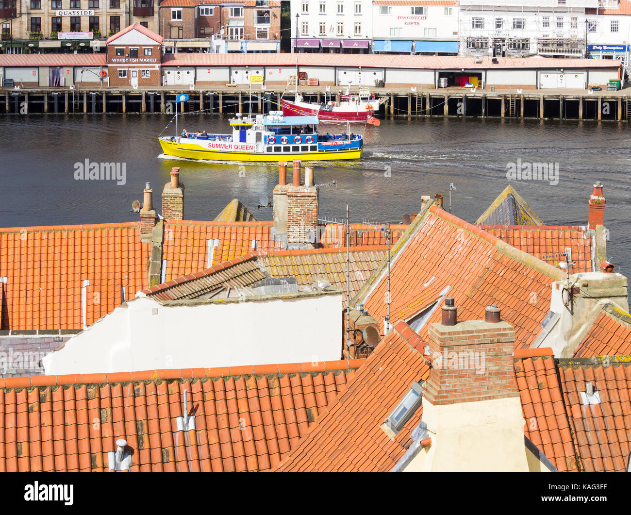 Whitby, North Yorkshire. UK. View over rooftops from 199 steps to one of the many boats that take tourists on short - Stock Image