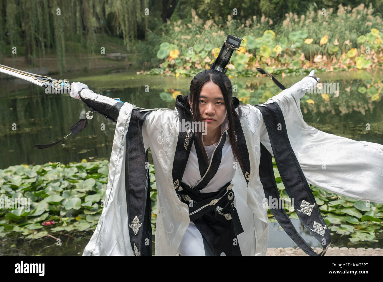 Chinese girl dresses as character from JX3 kingsoft games for cosplay photography in Beijing, China. - Stock Image