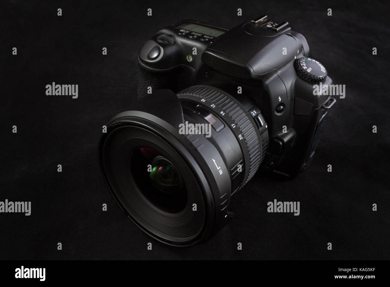 One black camera with wide angle lens isolated on black background, shot from slight;y elevated  viewpoint - Stock Image