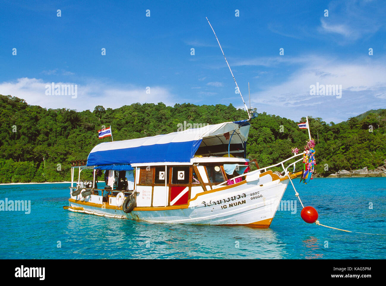 Thailand. Similan Islands. Water sports. Local dive boat moored off the beach. - Stock Image