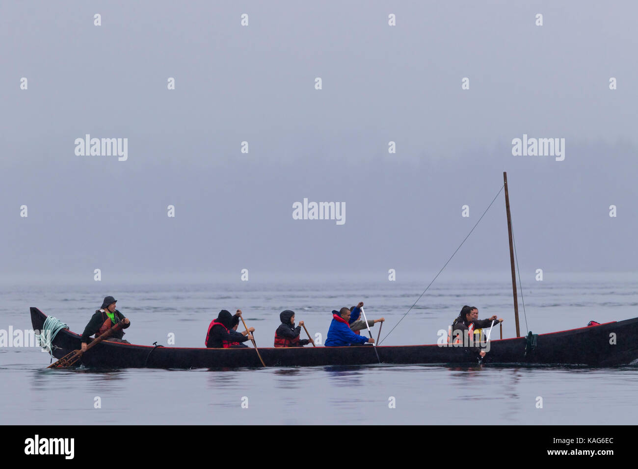 First Nations Natives In War Canoe Paddling Toward Swanson Island Protest Against Fishfarms British Columbia Canada