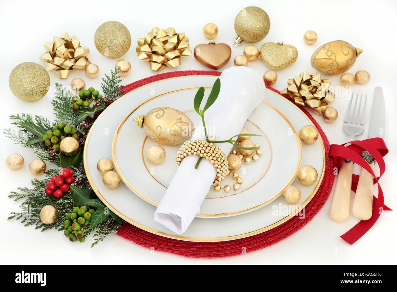 Christmas Dinner Table Setting With Porcelain Plates Napkin