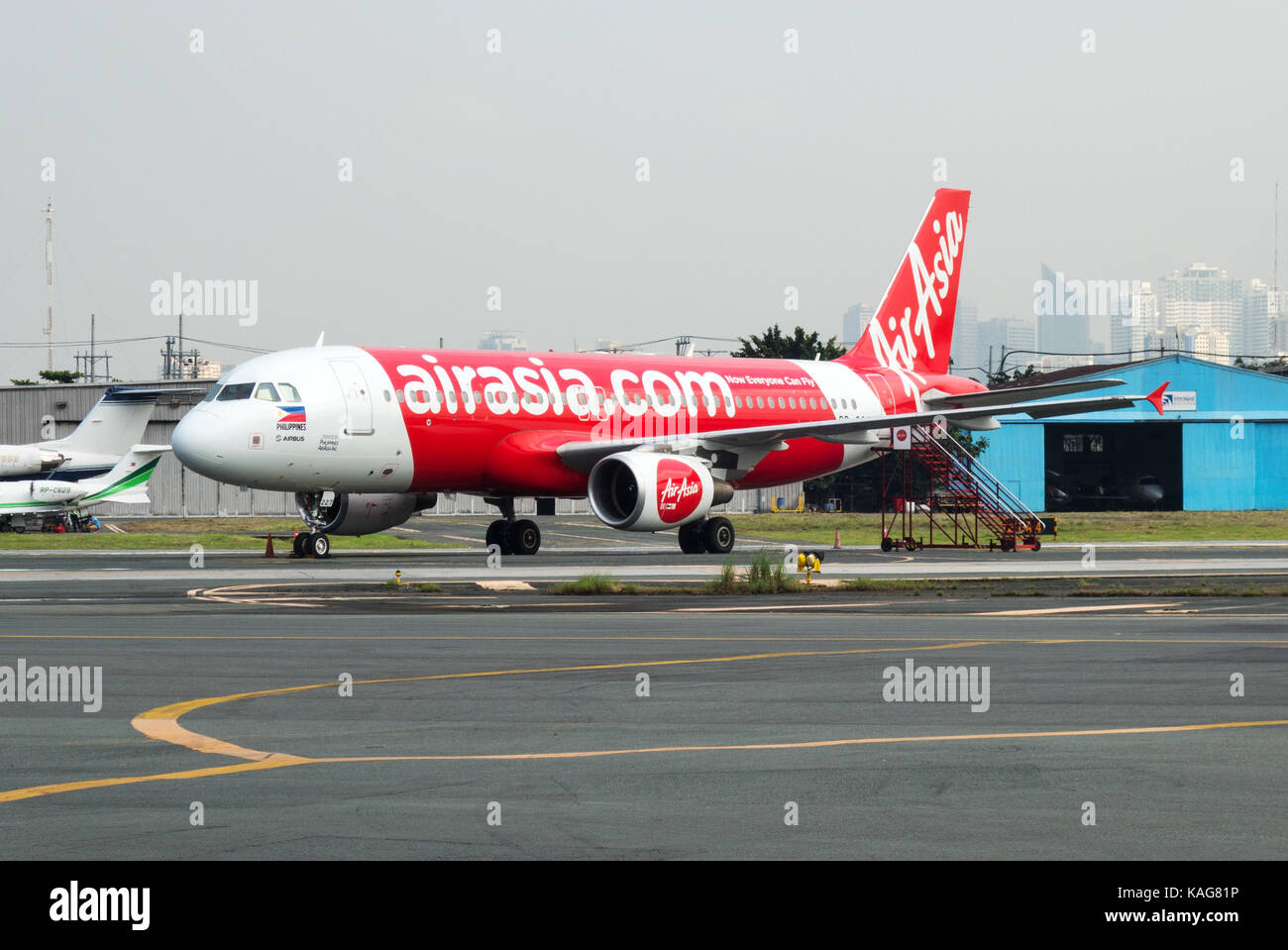An AirAsia plane on the ground at Ninoy Aquino International Airport, Manila, Philippines, Asia - Stock Image