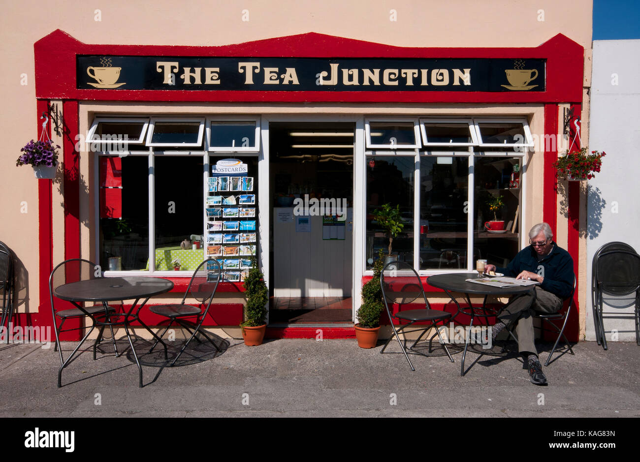 Man eating and reading newspaper at tea house in Ballyvaughan, County Clare, Ireland - Stock Image
