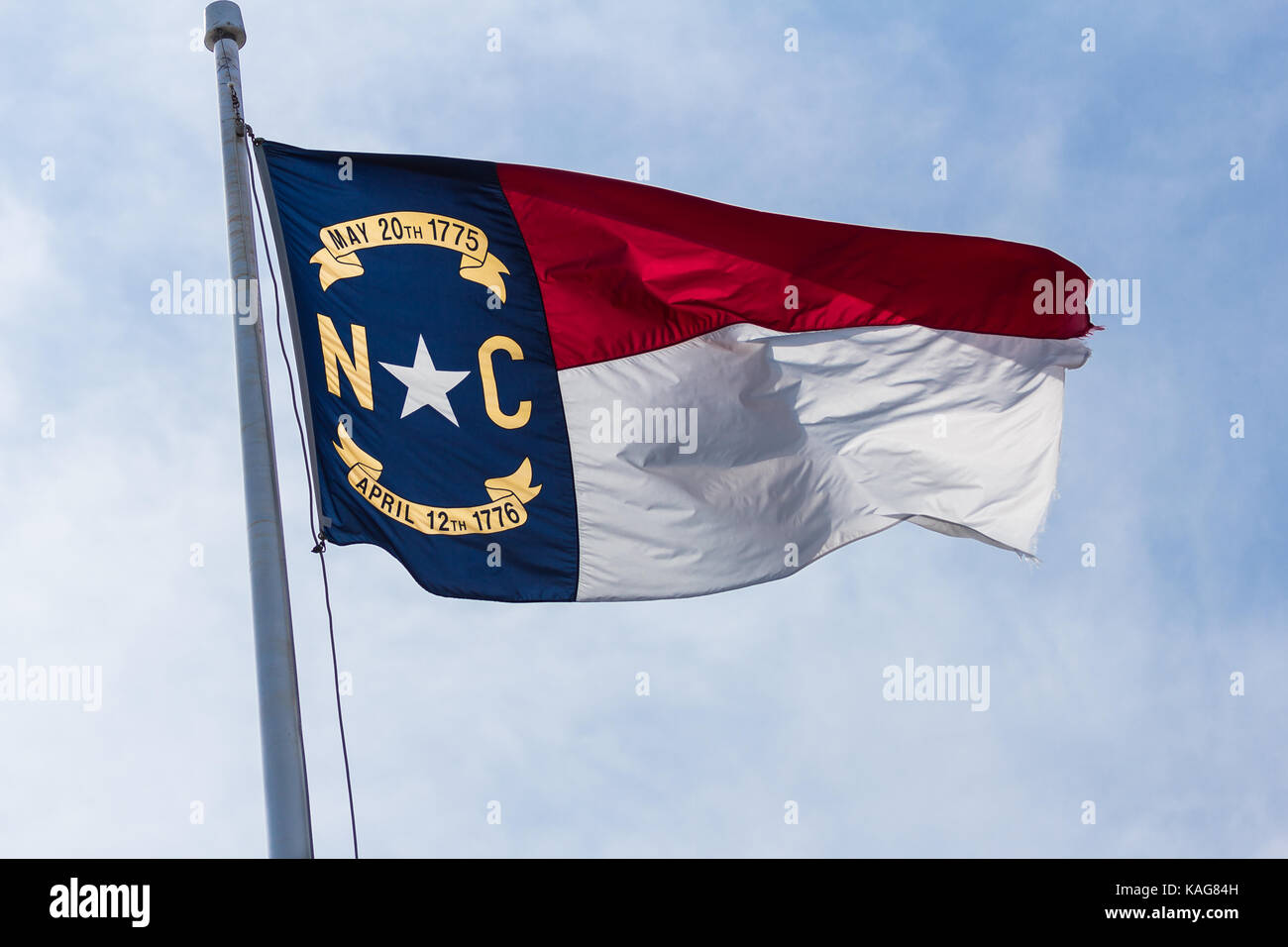 North Carolina State Flag flying in the wind at Fort Macon. Stock Photo
