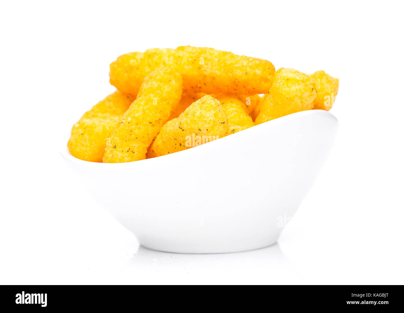 Cheese yellow corn snacks in white bowl on white background - Stock Image