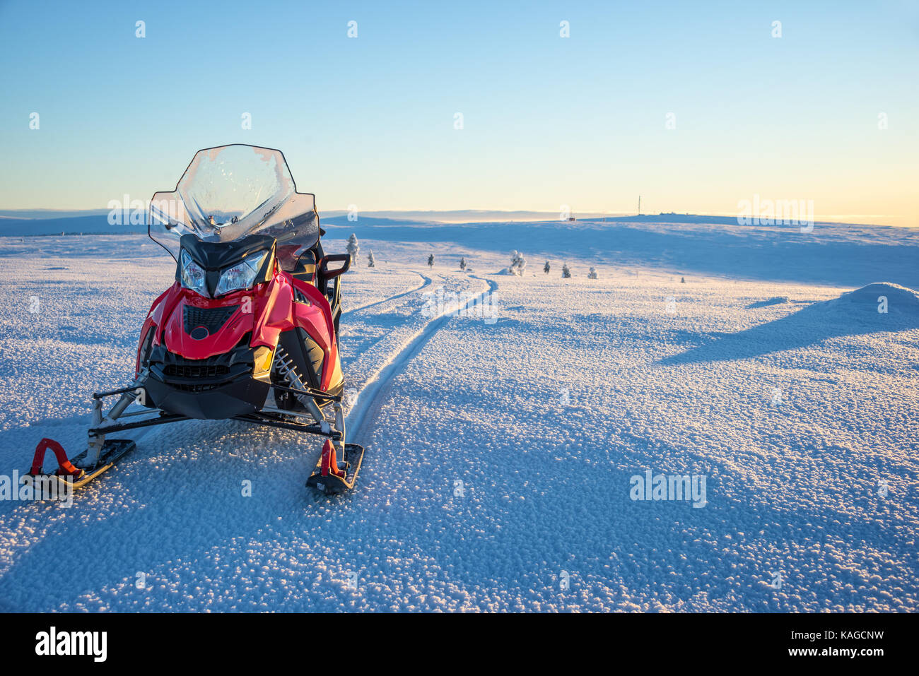 Snowmobile in a snowy landscape in Lapland, near Saariselka, Finland - Stock Image