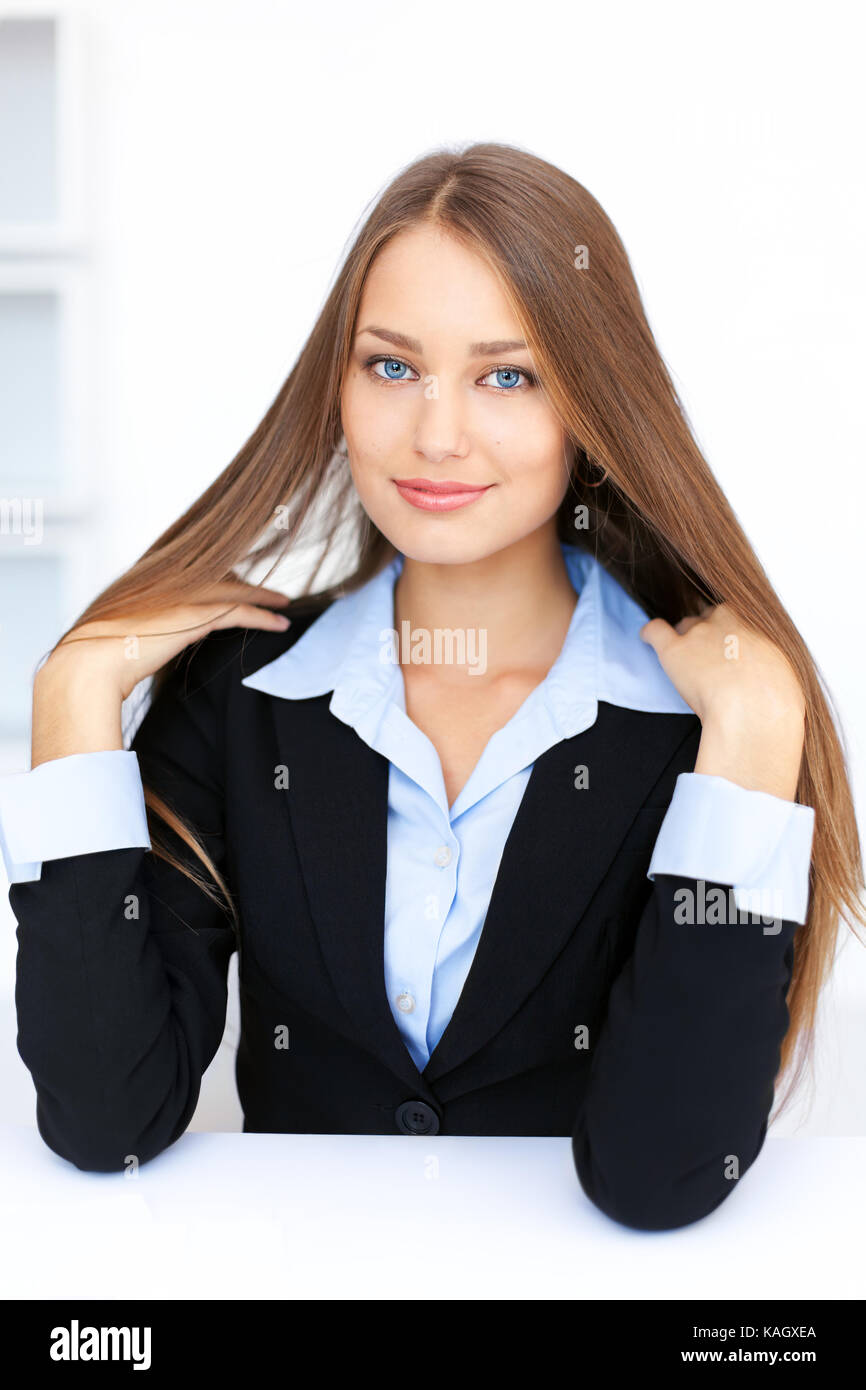 Portrait of cute young business woman with beautiful long straight hair Stock Photo