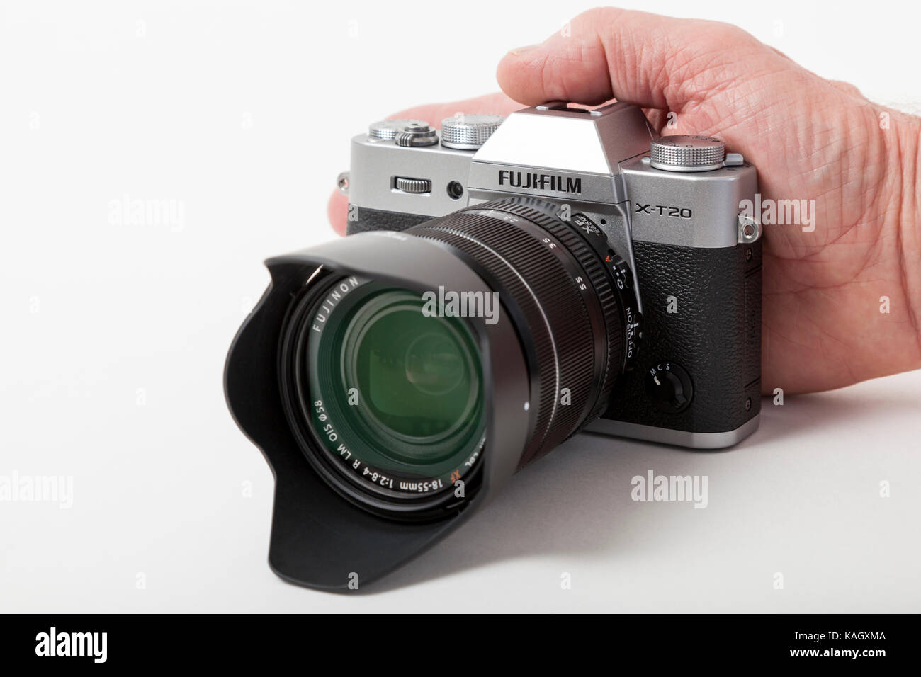 f59ea5c92b9 Fujifilm X-T20 mirrorless digital camera with the 18-55 mm lens against the  photographer's hand to show camera's small size