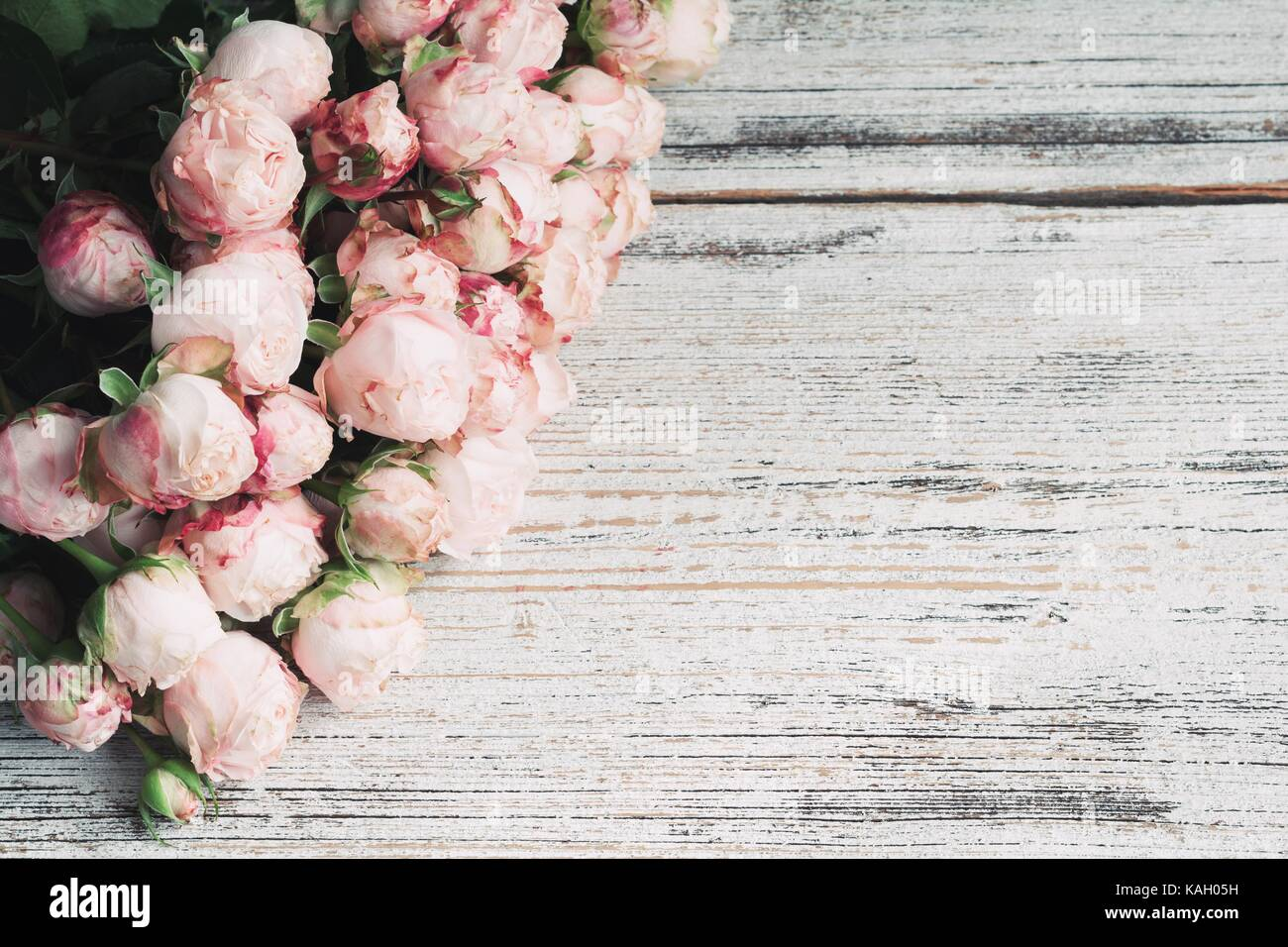 vintage wedding background high resolution stock photography and images alamy https www alamy com stock image pink roses on vintage wooden background floral frame background wedding 161413213 html