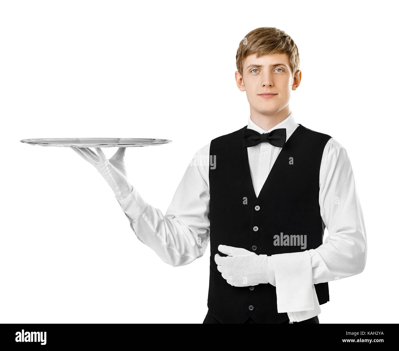 Portrait of young handsome waiter holding empty tray isolated on white background - Stock Image