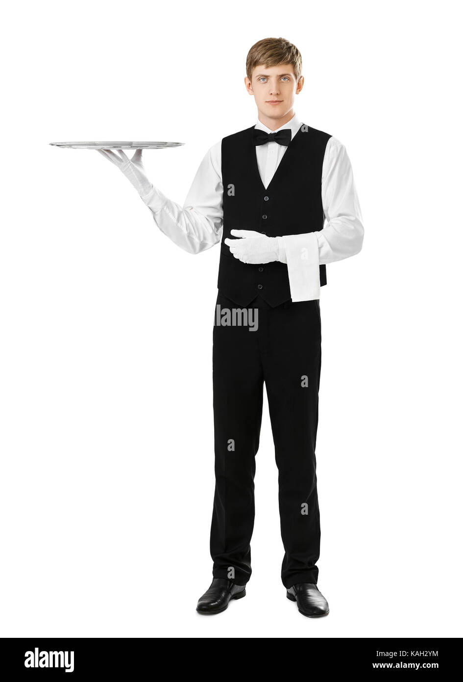Full length portrait of handsome elegant waiter holding empty silver tray isolated on white background - Stock Image