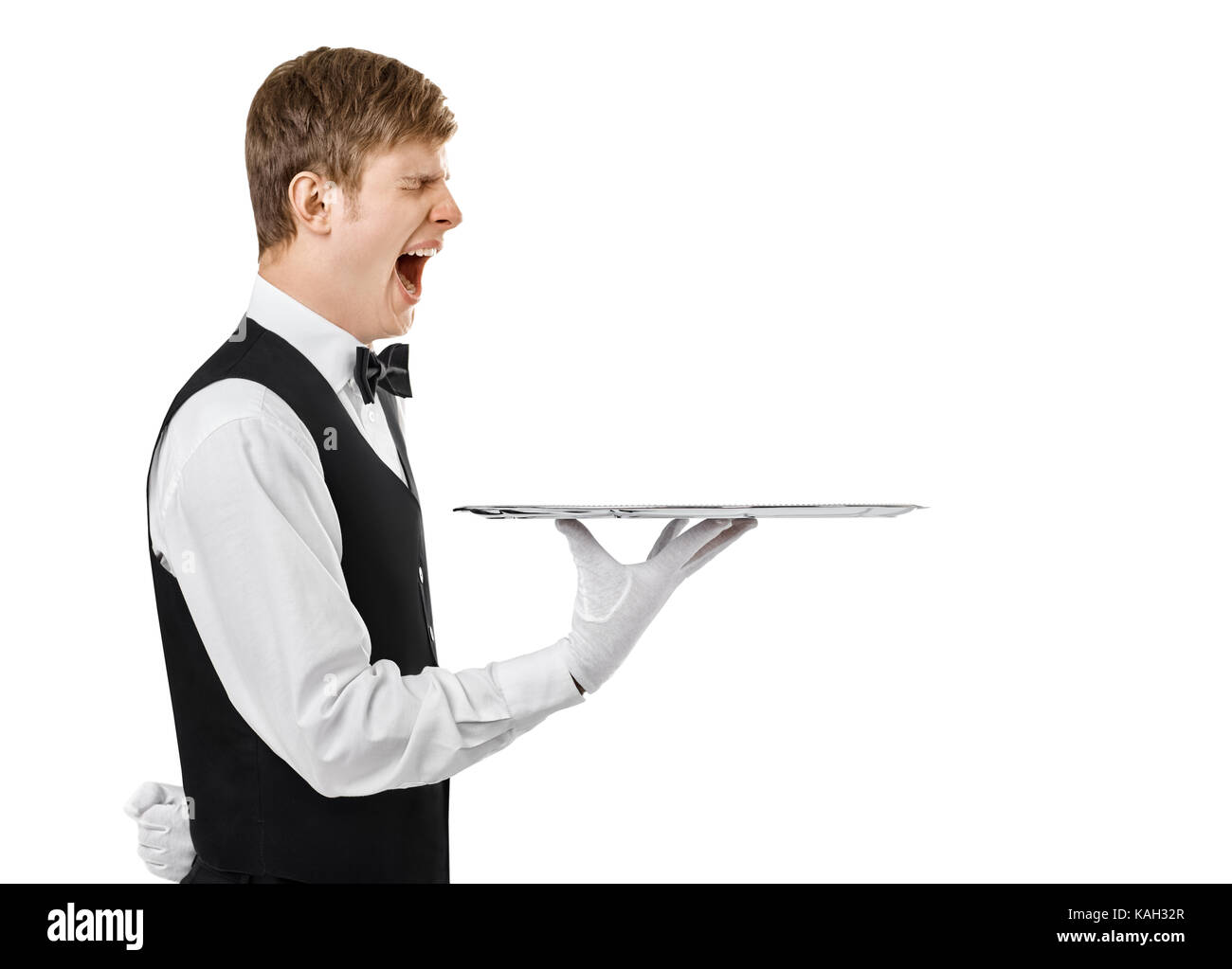 Profile portrait of bored yawning waiter holding empty tray isolated on white background with copy space - Stock Image