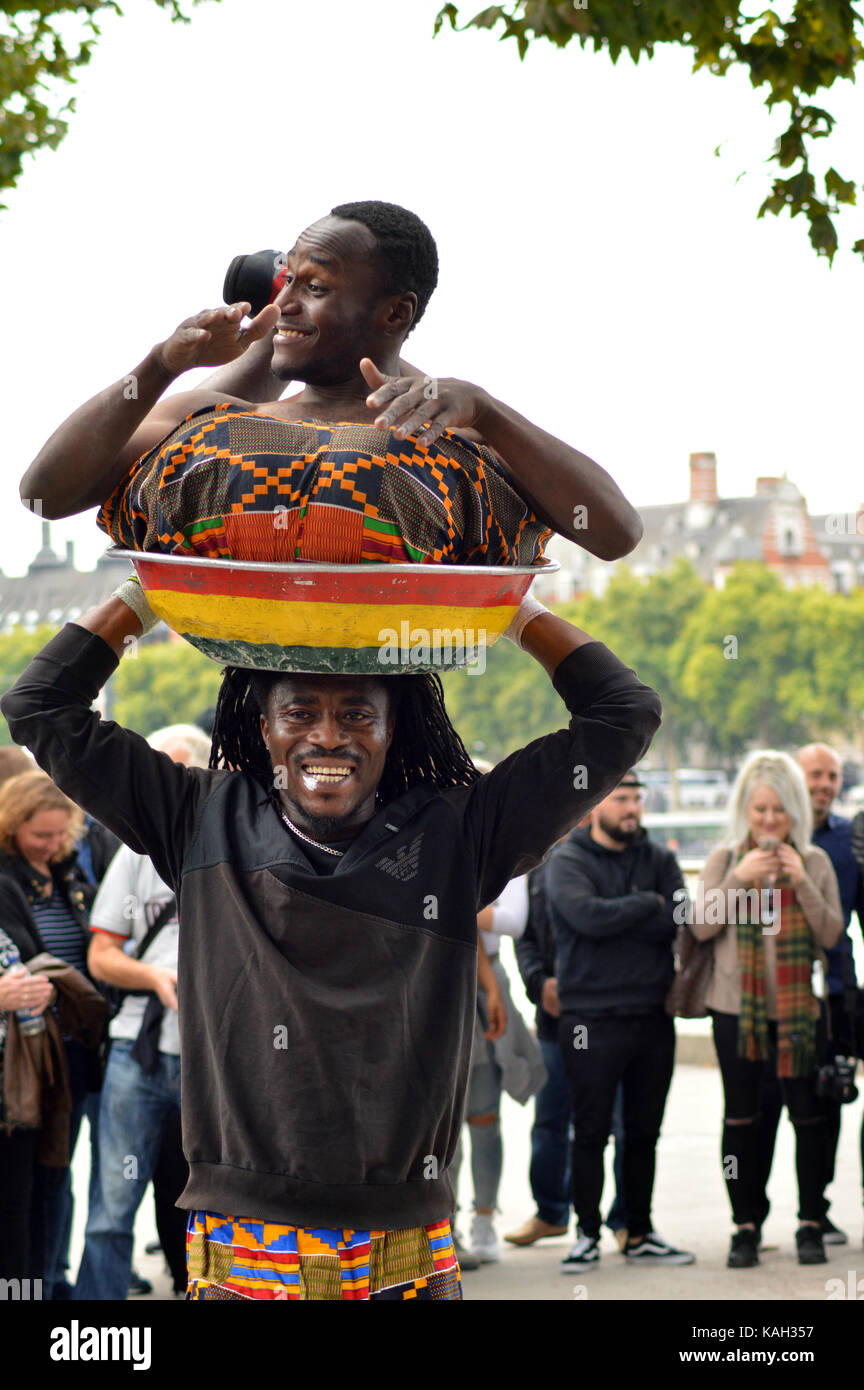 Two guys from Ghana entertaining the crowds on London's South Bank - Stock Image