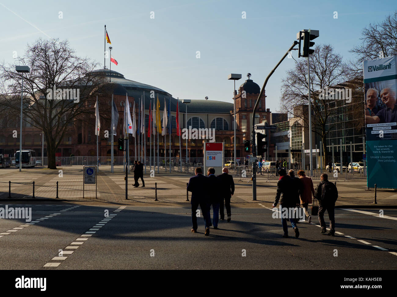 Frankfurt am Main, Germany - March 16, 2017: Men crossing the road in front of Messe Frankfurt Festival Hall (Festhalle Stock Photo