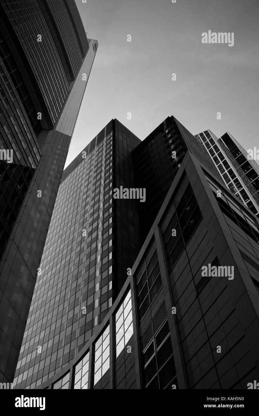 Frankfurt am Main, Germany - March 16, 2017: High-rise building adjacent to the Commerzbank tower; grayscale image Stock Photo