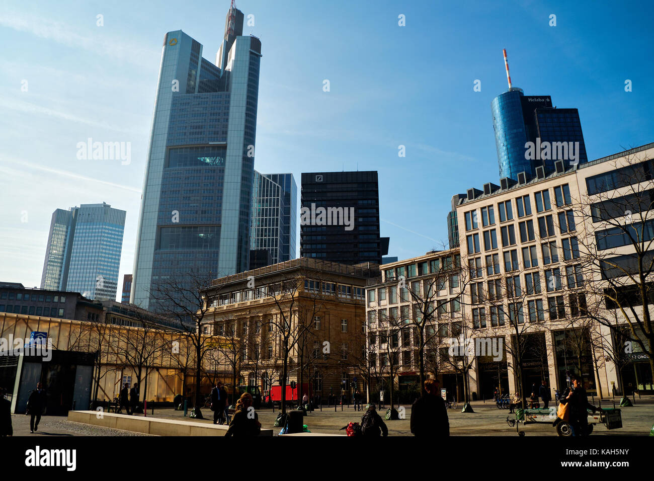 Frankfurt am Main, Germany - March 16, 2017: Goetheplatz with walking people, old buildings and modern skyscrapers Stock Photo