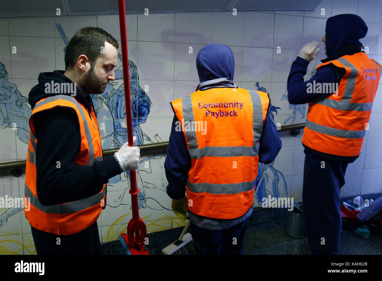 Offenders cleaning the tunnel walls of Hyde Park Corner tube as part of a community payback scheme. London. 05.04.2011. - Stock Image