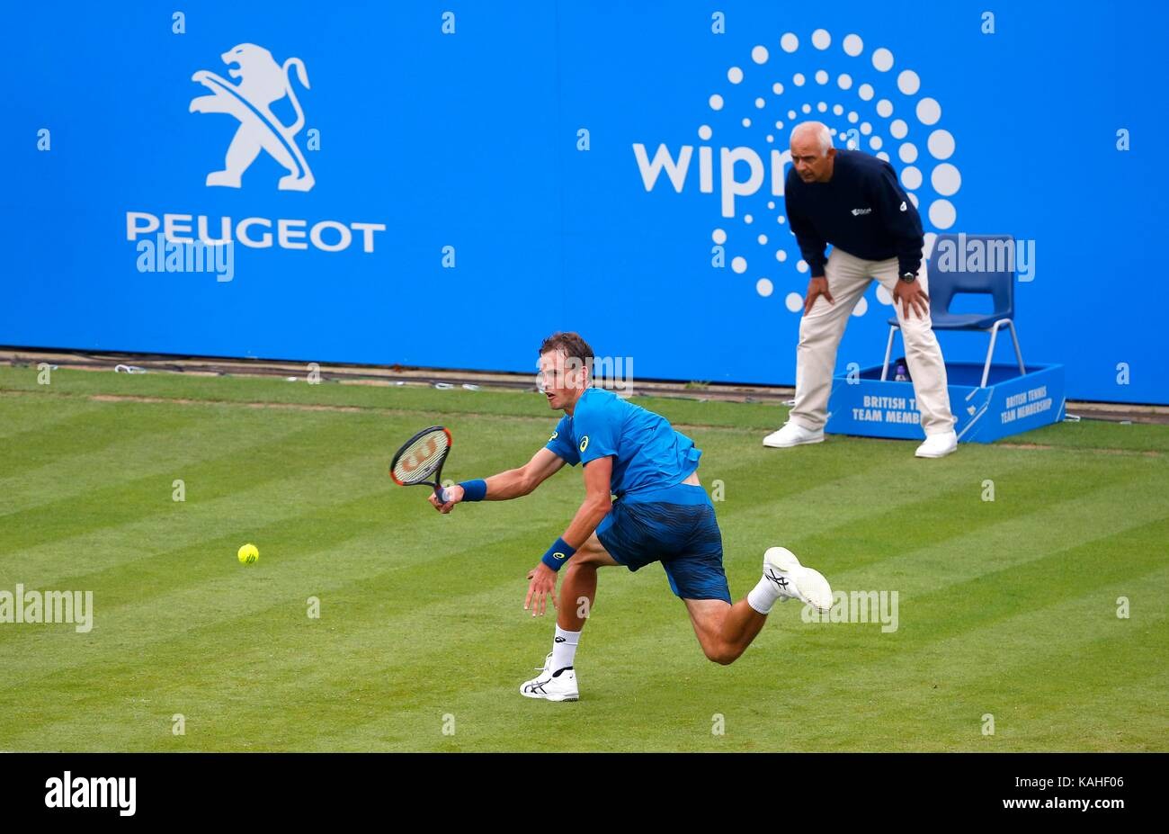 Vasek Pospisil of Canada in action against Novak Djokovic of Serbia on day six of the Aegon International at Devonshire - Stock Image