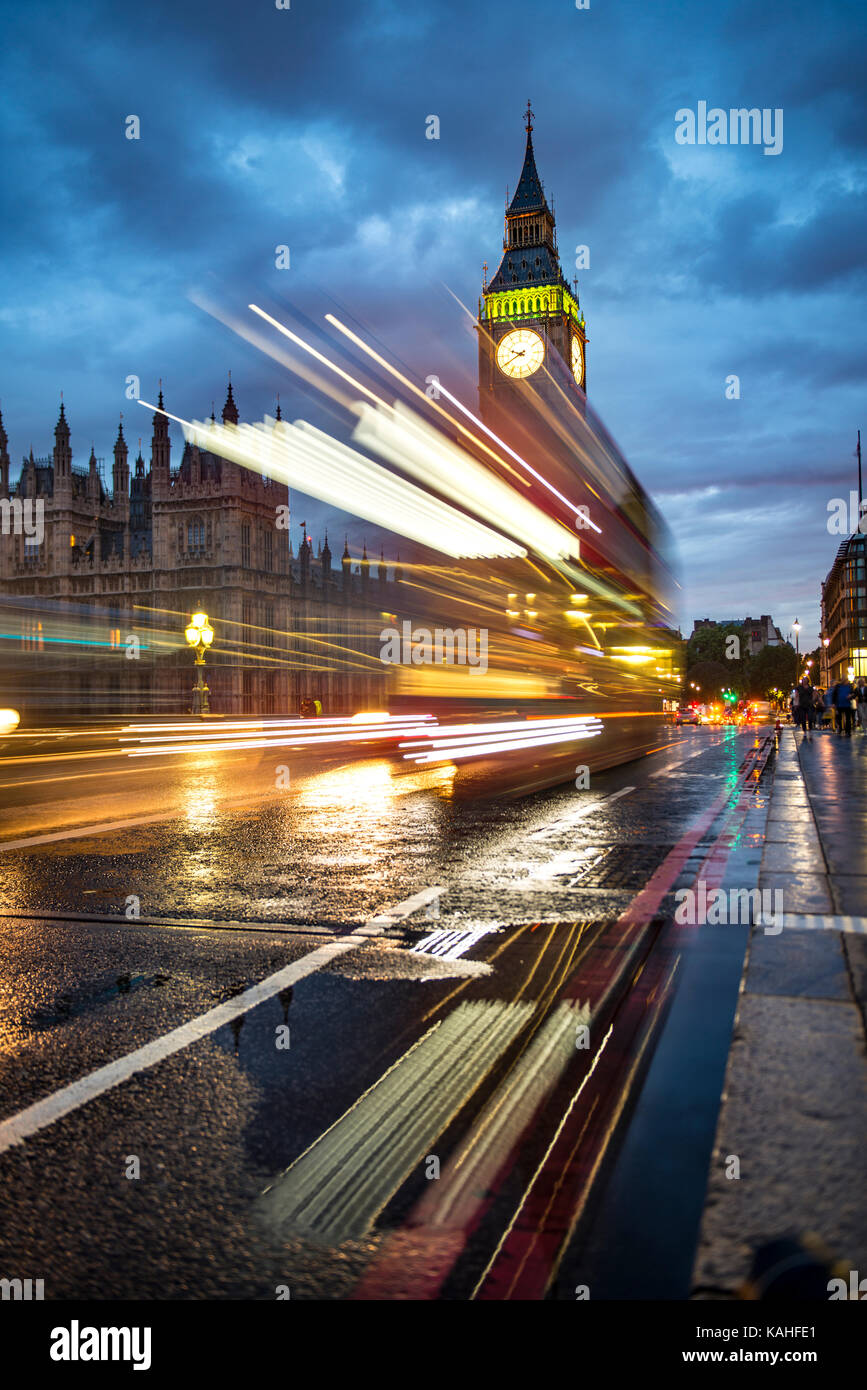 Traces of light, double-decker bus in the evening, Westminster Bridge, Palace of Westminster, Houses of Parliament, - Stock Image