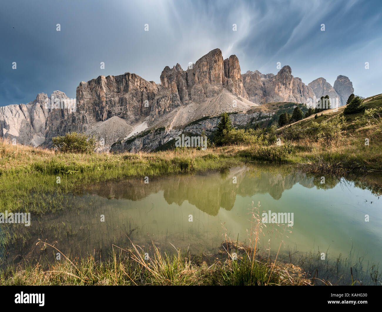 Sella Group with Piscadu reflected in a pond, Gardena Pass, Passo Gardena, nature park Park Puez Iceman, Dolomites Stock Photo