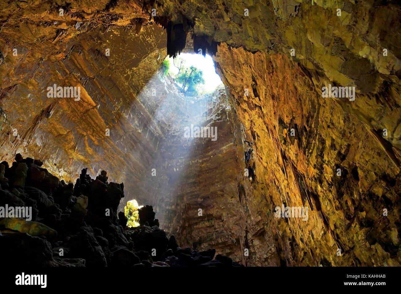 Light cone in the entrance area of the cave of Castellana Cave, Castellana Grotto, Province of Bari, Puglia, Italy - Stock Image