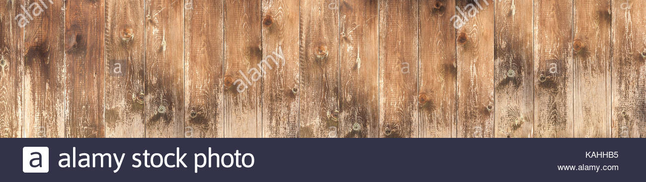 Rustic, weathered wood background. Old wooden wall with brown boards with peeling paint. - Stock Image