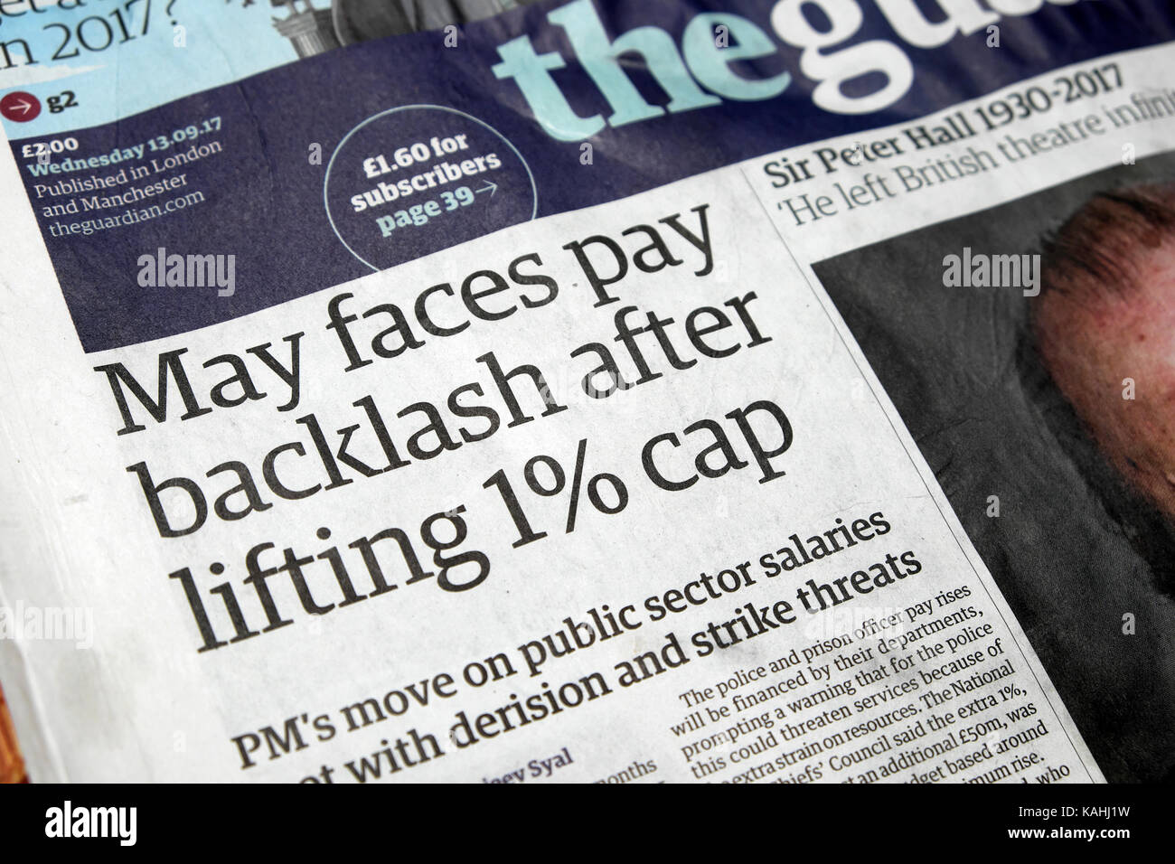 'May faces pay backlash after lifting 1% cap'  Guardian newspaper headline September 2017 - Stock Image