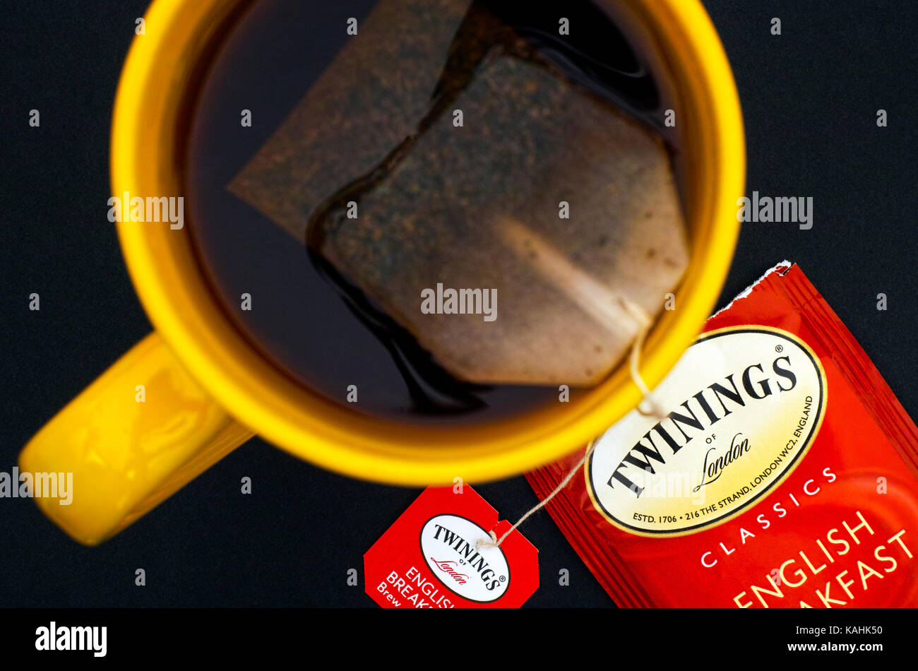 Tambov, Russian Federation - August 28, 2017 Cup of Twinings English Breakfast tea with teabag on black background. - Stock Image