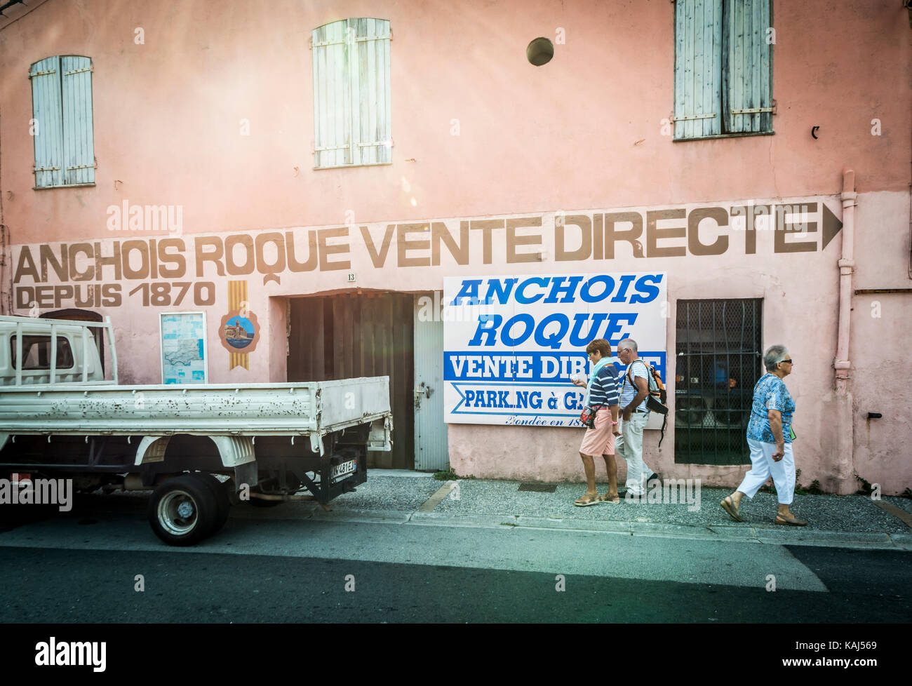 People outside the busy Roque Anchois anchovy factory shop in Collioure Languedoc Roussillon France - Stock Image