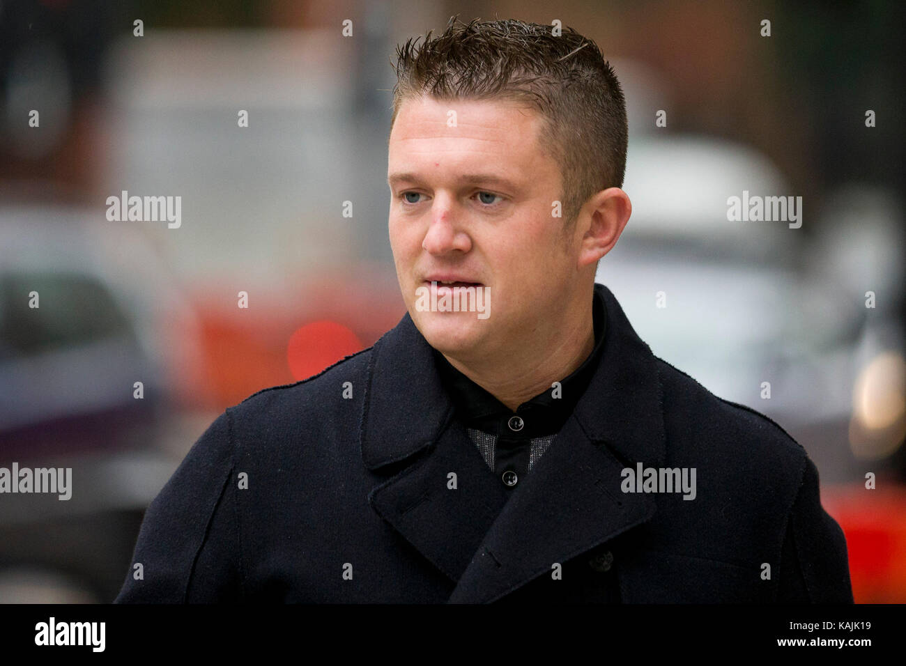 Former EDL leader Tommy Robinson arrives at Westminster Magistrates Court in London on 16 10 2013 after being charged - Stock Image