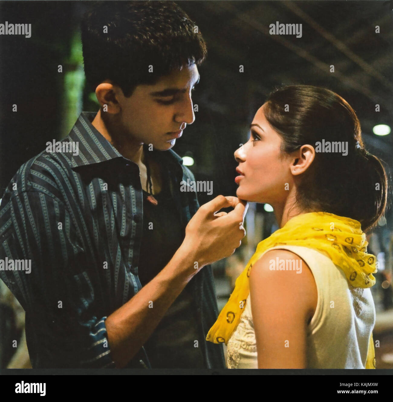 SLUMDOG MILLIONAIRE 2008 Warner Bros film with Dev Patel and Frieda Pinto - Stock Image
