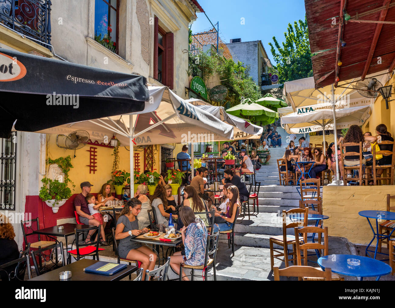 Cafes and tavernas on Mnisikleous Street in the Plaka district, Athens, Greece - Stock Image
