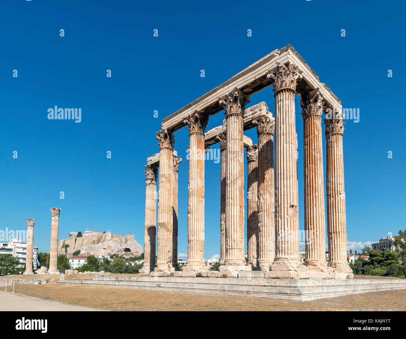 The Temple of Olympian Zeus (Olympeion) with the Acropolis in the background, Athens, Greece - Stock Image