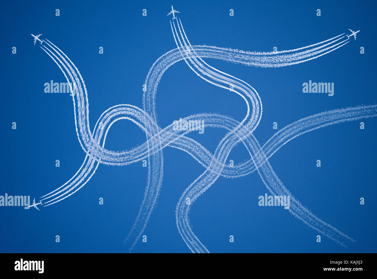 Chaotic, confused, stressful symbol of tangled aircraft vapor trails. - Stock Image