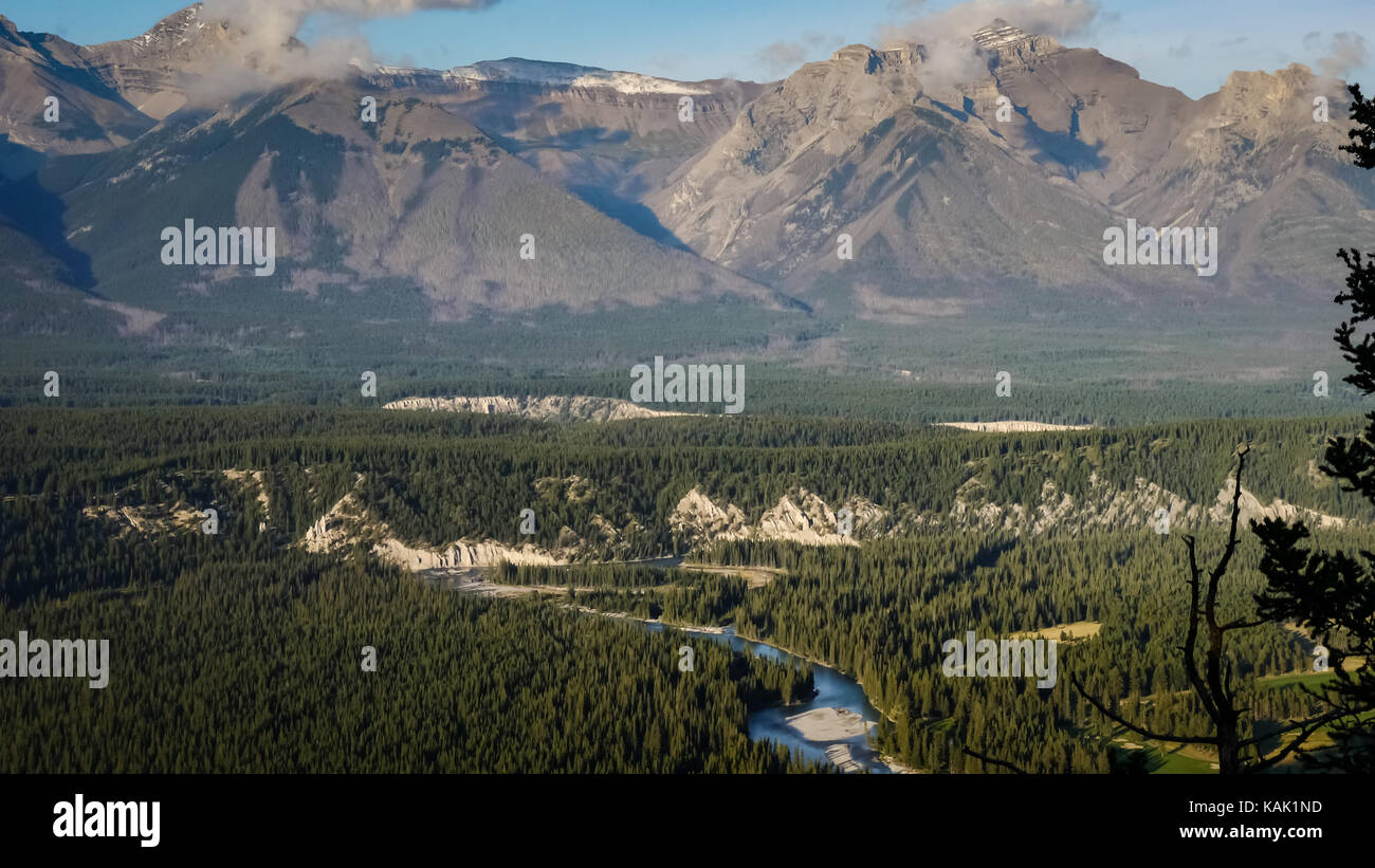 View over the Bow River winding its way through the valley, mountains in the background (Tunnel Mountain, Banff - Stock Image