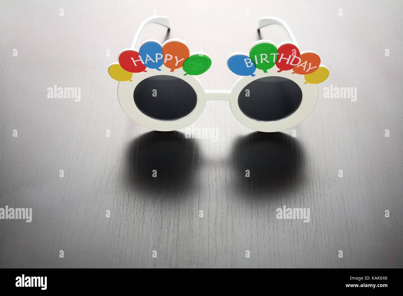 Party Eyewear on Wooden Background - Stock Image