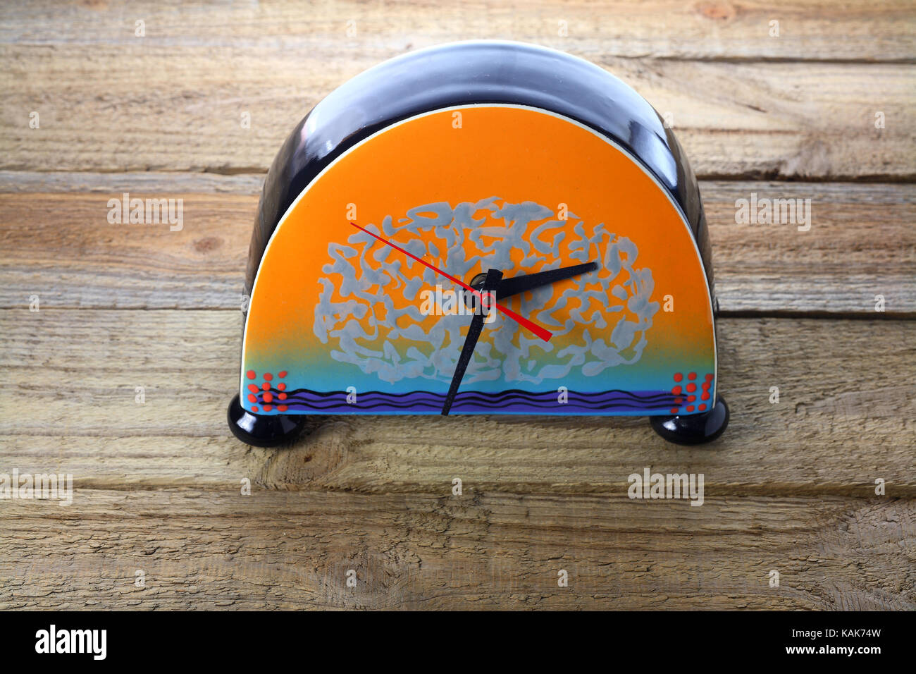 Clock on Wooden Background - Stock Image