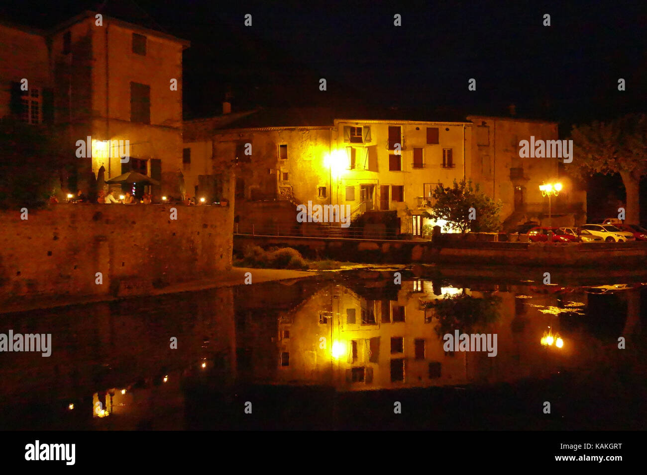 Chateau de Lunas, historic former chateau now a restaurant overlooking river in small town of Lunas near Lodeve - Stock Image